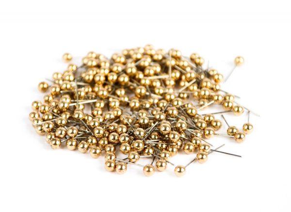 okrągłe złote pinezki do tablicy korkowej